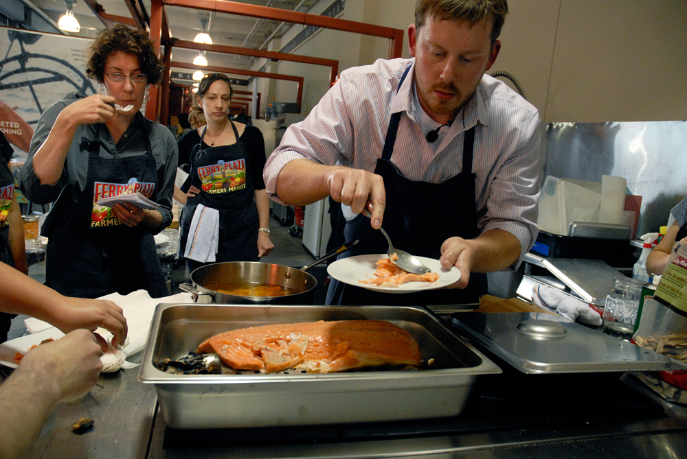 Chef Neil Davidson serves up the smoked salmon to enthusiastic students. Photo: Wendy Goodfriend