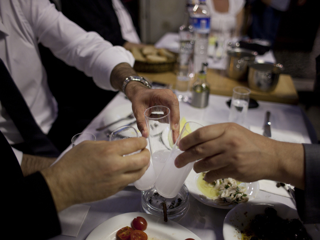 Diners drinking raki, a traditional Turkish alcoholic drink flavored with anise, at a restaurant in Istanbul. Photo: Jodi Hilton for NPR