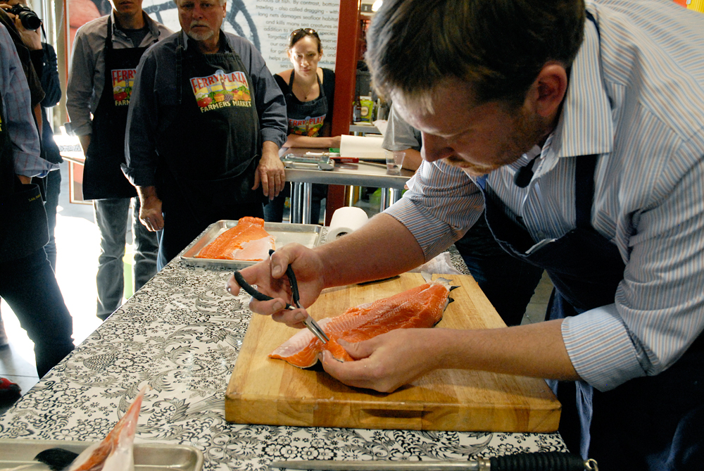 Chef Neil Davidson uses needle-nose pliers to remove pin bones from salmon. Photo: Wendy Goodfriend