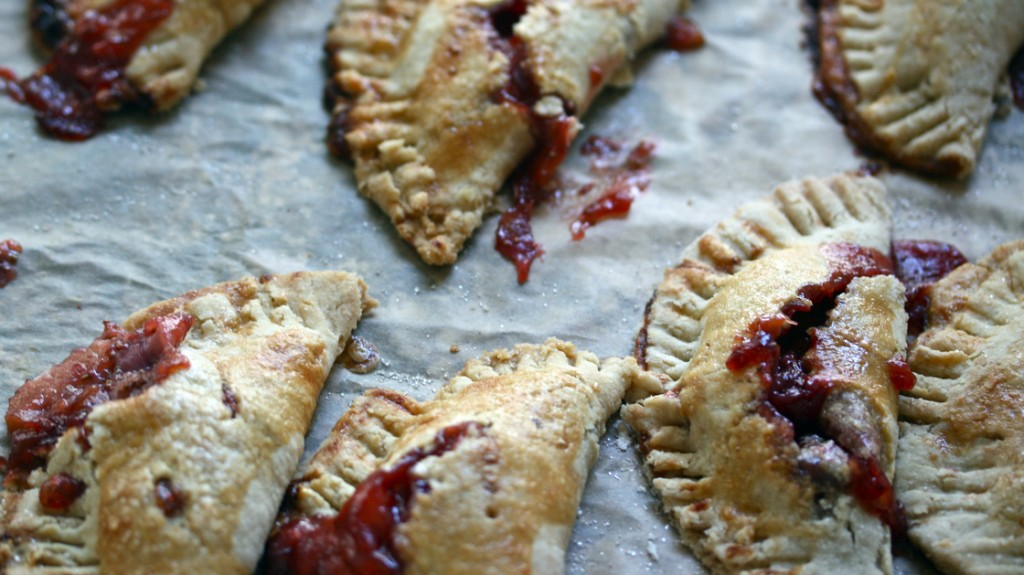 Strawberry-Rhubarb Hand Pies on parchment. Photo: Nicole Spiridakis for NPR