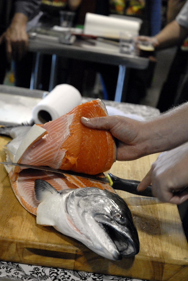 Chef Neil Davidson filleting a whole salmon. Photo: Wendy Goodfriend