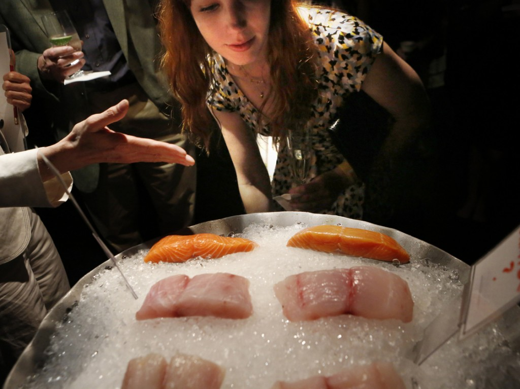 Jessica McConnell, 26, of Silver Spring, Md., tries to identify various species of fish — halibut, red snapper and salmon — that are commonly mislabeled. Photo: Heather Rousseau/NPR