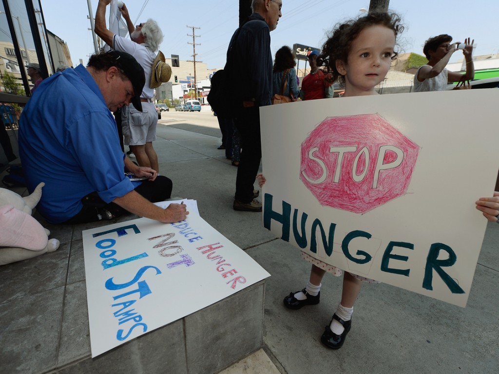 Gracie Shannon-Sanborn, 5, holds a sign as she joins her father Allen Sanborn (L) and members of Progressive Democrats of America at a rally in front of Rep. Henry Waxman's office on June 17, 2013 in Los Angeles, Calif. The protestors asked the congressman to vote against a House farm bill, which was defeated Thursday. Photo: Kevork Djansezian/Getty Images