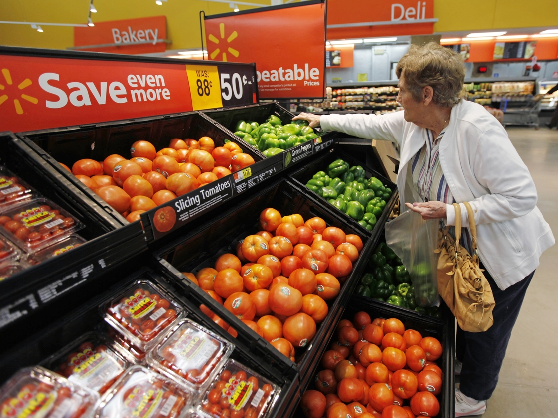 A shopper selects produce at a Wal-Mart in Deptford, N.J. Photo: Matt Rourke/AP