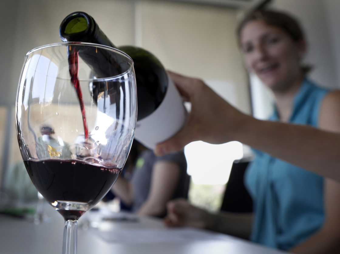 Swigging for science: A hint of oak, our winetasting newbies learned, is more common in reds than whites. It's a marker for expense in both. Photo: Heather Rousseau/NPR