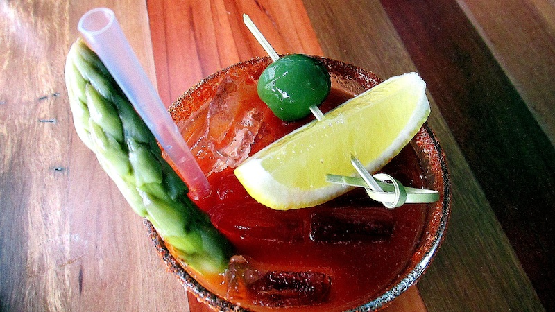 Rimmed with chile powder and salt, the bloody mary comes with a spear of picked asparagus, olive and lemon. Photo: Jonathan Darr