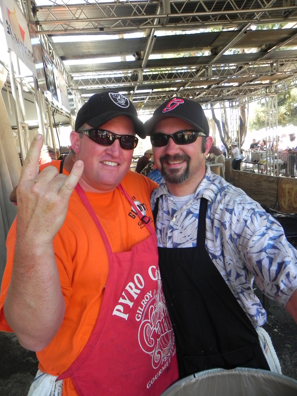 Rich Janisch (left) and Scott Povio (right) of Gilroy have been volunteering at the festival for years. Neither are professional chefs. They just love to cook, especially with garlic. Photo: Gina Scialabba
