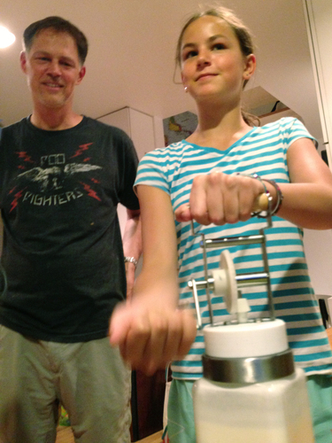 Riley Casagrande churns butter with her dad Jerry Casagrande. Photo: Allison Aubrey/NPR