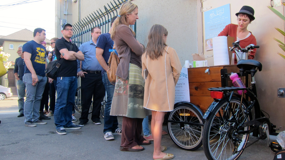 Curbside Creamery's Tori Wentworth dishes out free samples at a recent First Friday event held in Oakland's Temescal Alley