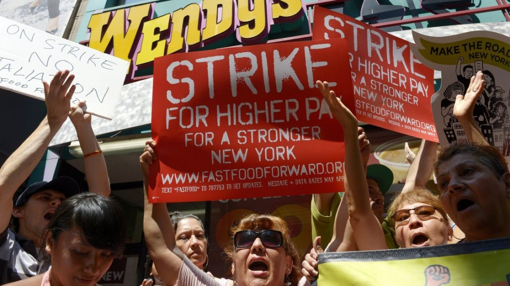 People gathered outside a Wendy's restaurant in New York City on Monday as part of a one-day strike calling for higher wages for fast-food workers. Photo: Justin Lane/EPA/Landov
