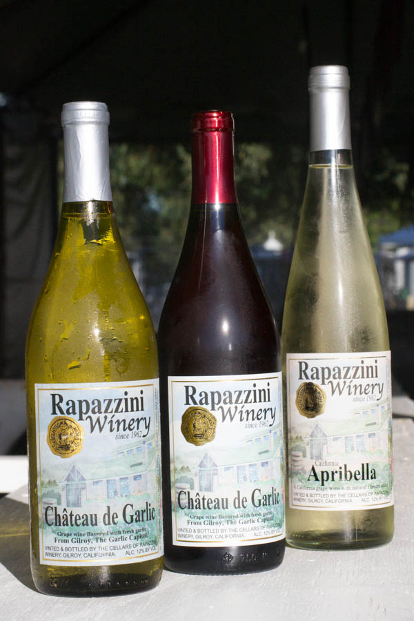 An assortment of wines by the Rapazzini Winery, based in Gilroy, Calif., including a red and a white garlic-infused wine that are available for tasting at the Gilroy Garlic Festival. Photo: Sara Bloomberg