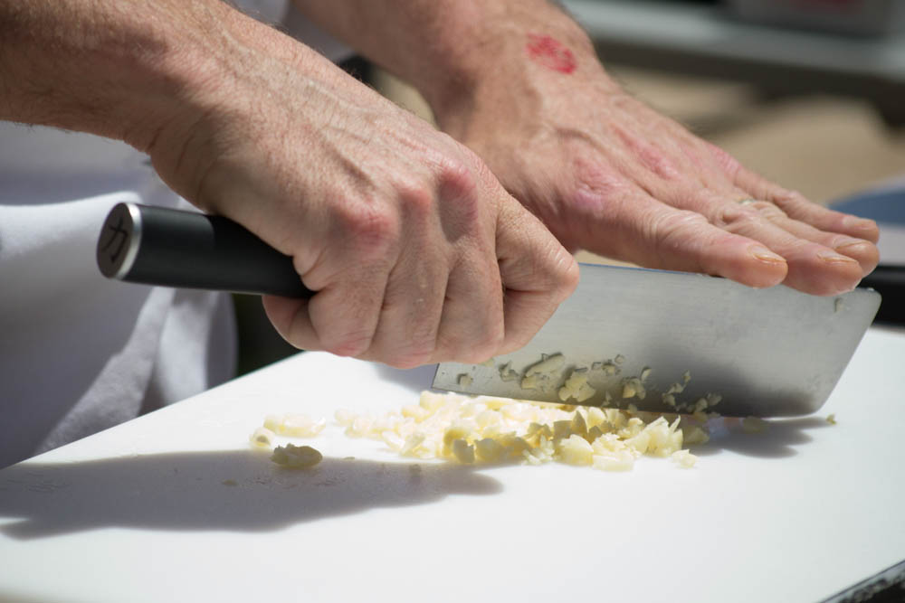 Chef Bryan Kramer from Fresno State University chops garlic for the Garlic Bowl cook-off at the Gilroy Garlic Festival. Photo: Sara Bloomberg