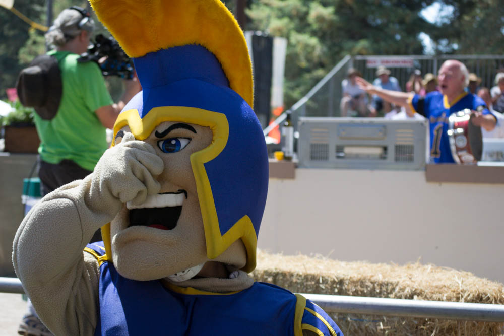 "San Jose State University's mascot, The Spartan, plugs his nose as ""Krazy"" George Henderson, right, instructs the audience to do the same at the inaugural Garlic Bowl cook-off at the Gilroy Garlic Festival. Henderson claims to have invented ""the wave,"" which is now ubiquitous at sporting events.  Photo: Sara Bloomberg"
