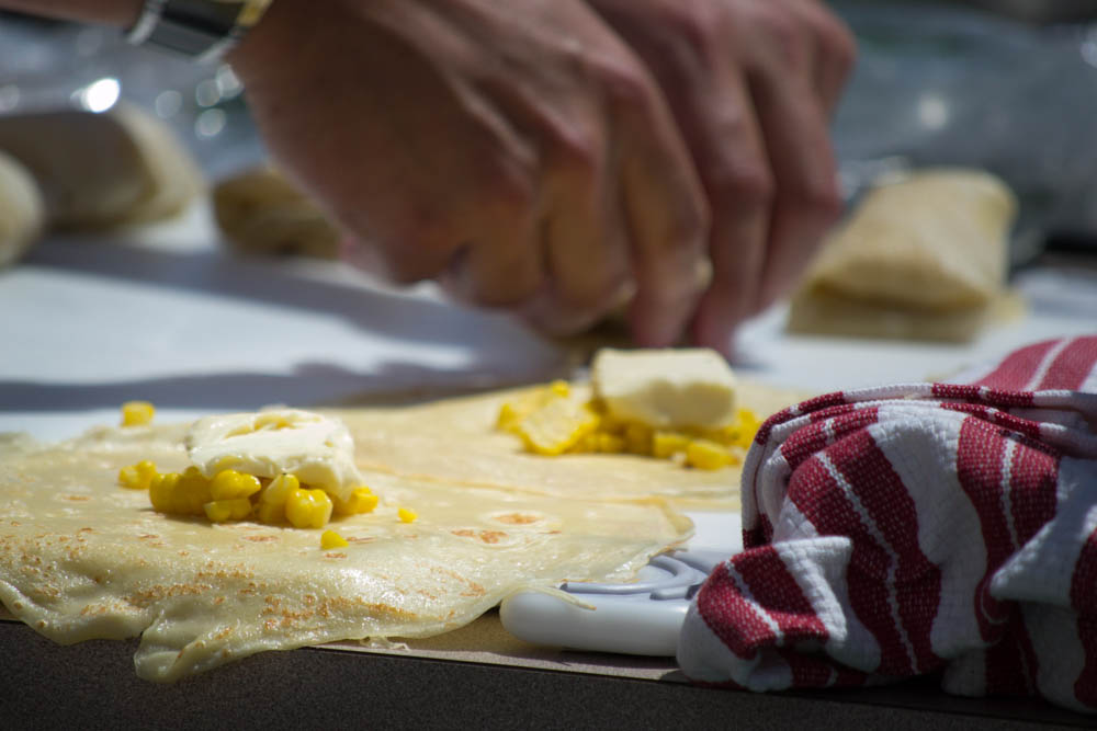 Chef Erik Debaude prepares corn and St. André stuffed crepes with a tarragon and lavender garlic cream sauce during the Garlic Bowl cook-off at the Gilroy Garlic Festival. Photo: Sara Bloomberg