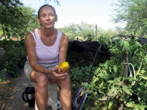 Food bank client Jamie Senik takes a break near her garden plot sponsored by the Community Food Bank of Southern Arizona. She grows food for herself and her diabetic mother. Photo: Pam Fessler/NPR