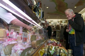 Christopher Lane tries some cheese at Lucca. He's been a loyal customer for about 40 years. Photo by Sara Bloomberg