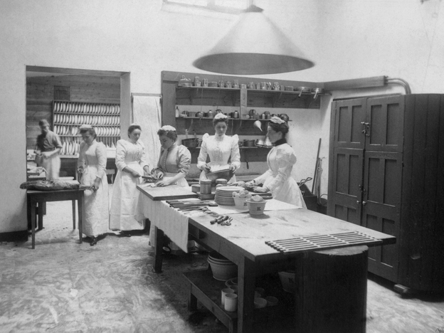 Maids at work in a large kitchen, circa 1890. Photo: W. and D. Downey/Getty Images