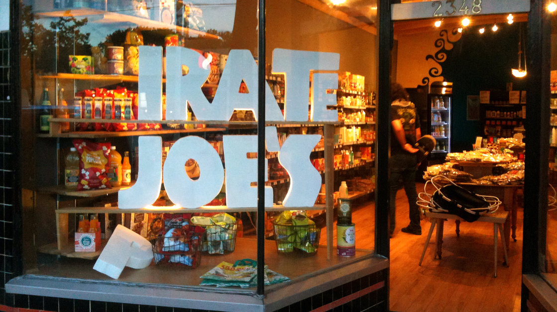 """I bought the stuff at full retail. I own it,"" says Michael Hallatt, owner of the _irate Joe's grocery in Vancouver. His store faces a lawsuit from Trader Joe's for infringing on its trademark and possibly confusing customers. Photo:_irate Joe's"