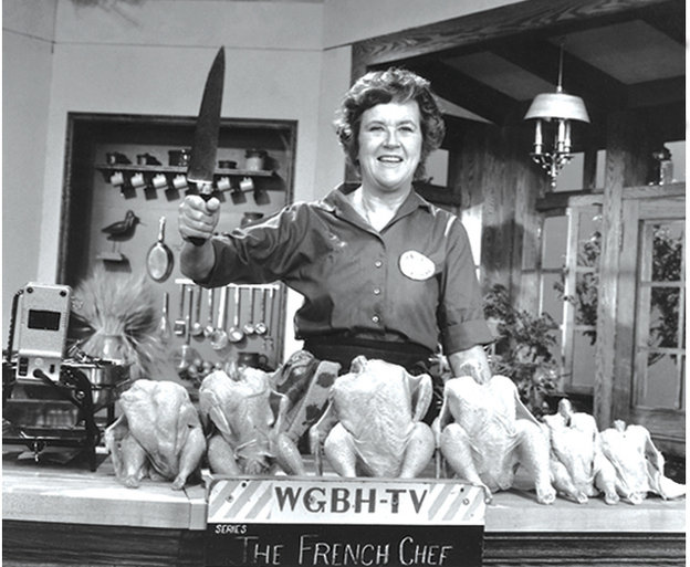 "Julia Child poses with ""the chicken sisters"" before an episode of The French Chef in which she teaches us how to roast a bird. Photo: Courtesy of Paul Child/PBS"