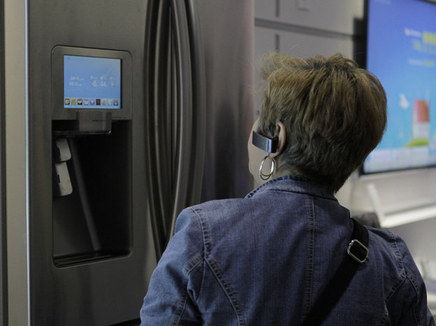 A woman checks out a smart refrigerator at a consumer electronics show in 2012. Photo: Samsung