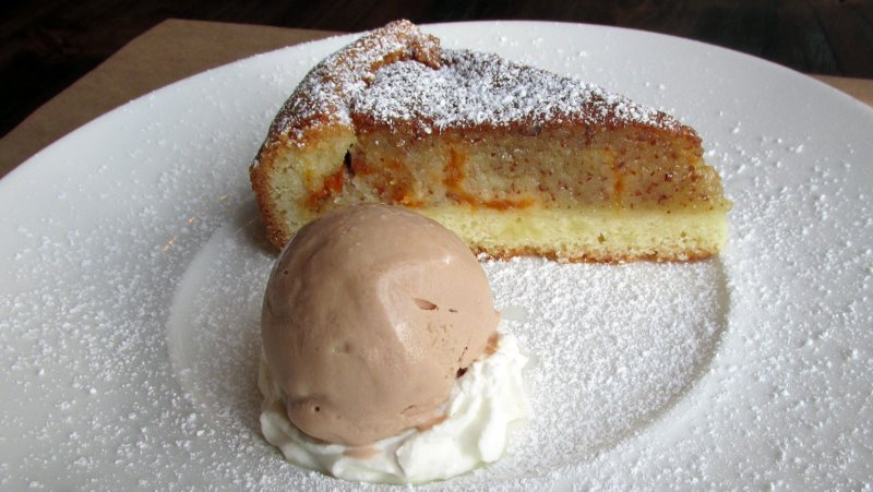 Torta di Madorla e Albococche. (Apricot and almond torte with Vin Santo and hazelnut gelato.) Photo: Jonathan Darr