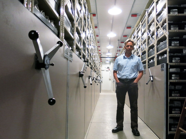 Dave Dierig, research leader at the National Center for Genetic Resources Preservation, stands among the ceiling-high shelves that hold the 600,000 seed packets in this cold storage vault. Photo: Grace Hood/KUNC