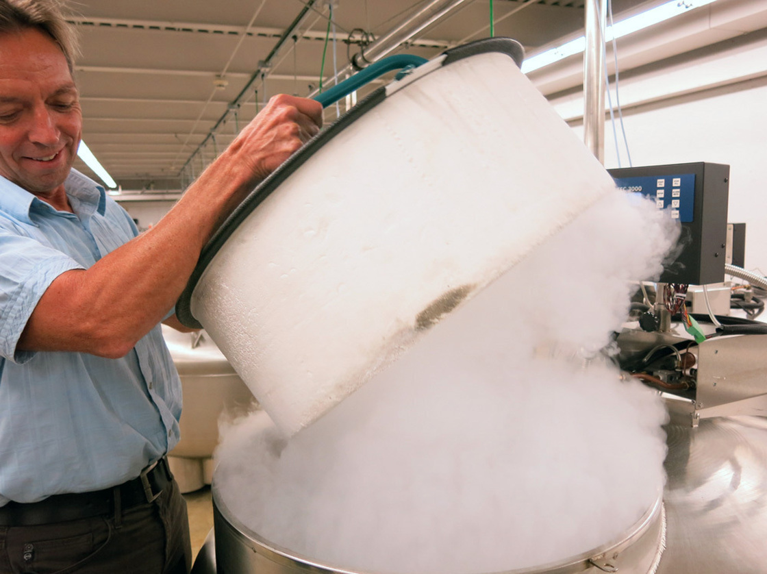 """You'll want your camera out for this,"" Dierig said as he lifted up the lid to a cryogenic freezer capsule. In the cryo chamber, the collection expands to include not just seeds, but animal embryos, semen and microbes. Photo: Grace Hood/KUNC"