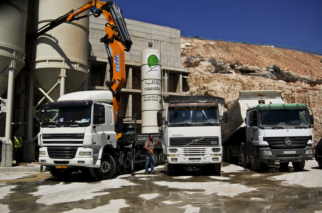 Cement mixers in Rawabi, a planned Palestinian town in the West Bank, about 25 miles north of Jerusalem. Photo: Emily Harris/NPR