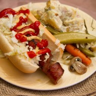 Spiral dog with homemade sauerkraut, pickles, and dilly potato salad