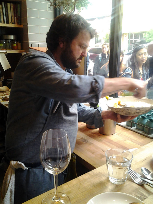 Stuart Brioza plating dinner at State Bird Provisions. Photo: Mary Ladd