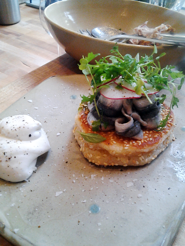 State Bird's sesame pancake with pickled anchovy and creme fraiche. Photo: Mary Ladd