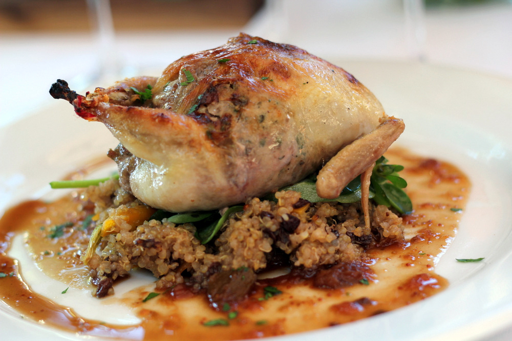 Boetticher and Miller's recipe for fig and sausage stuffed quail, which is a hit in their stores, is included in the cookbook. Photo: Kate Williams