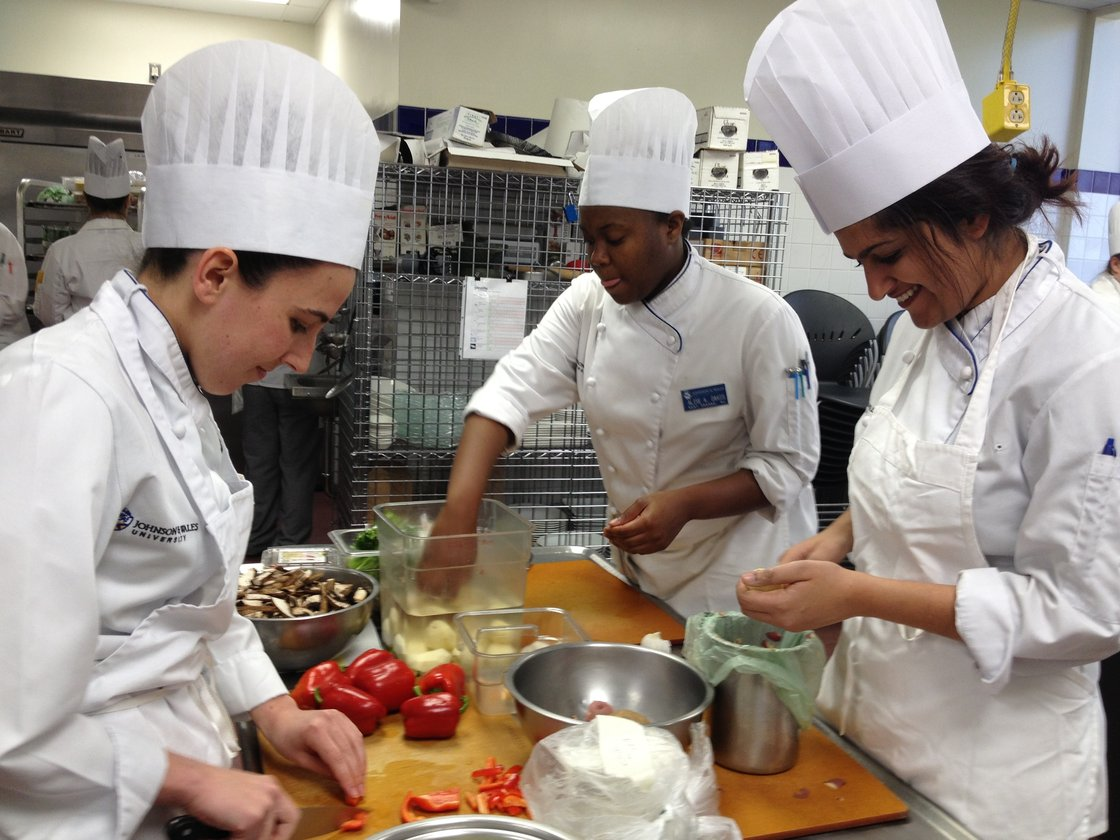 Fourth year Tulane medical school student Neha Solanki (far right) preps a Greek frittata during a class at Johnson & Wales. Photo: Kristin Gourlay/ RIPR