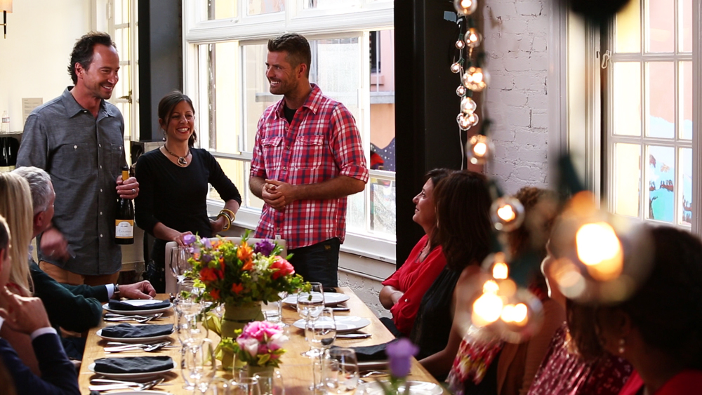 Chefs Jeffrey Saad, Cortney Burns and Pete Evans with dinner guests. Photo courtesy of Moveable Feast with Fine Cooking