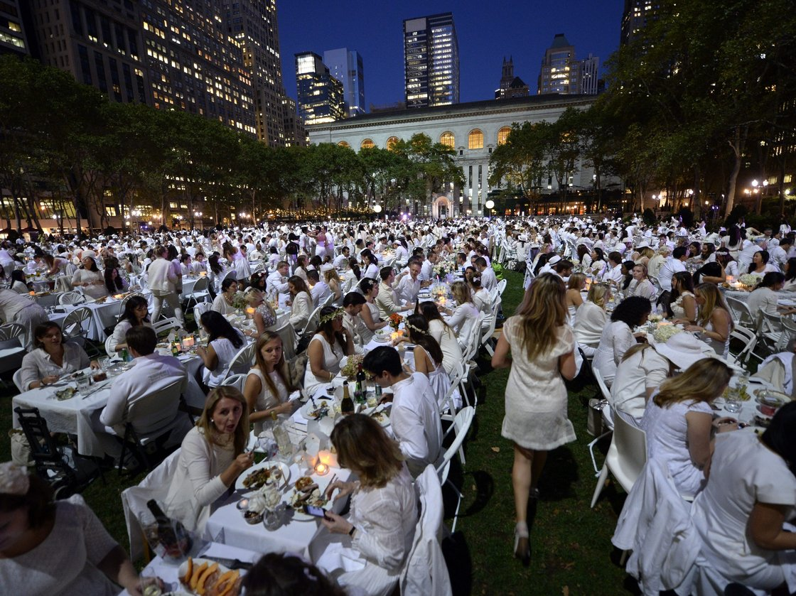 Some 4,000 guests, all dressed in white, showed up for the secret dinner party in New York City's Bryant Park. Photo: Timothy Clary/AFP/Getty Images