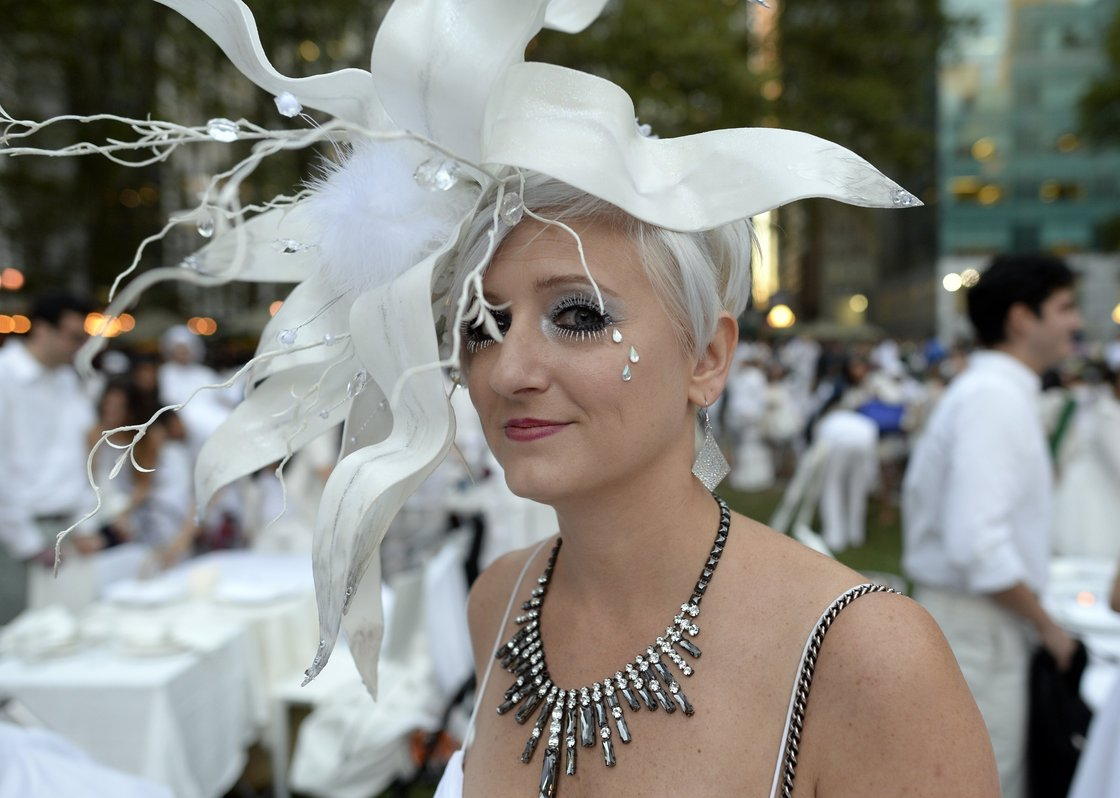 Many guests see Diner en Blanc as an occasion to unleash their fashion whimsy. The event is always held outdoors, always at a landmark location revealed at the last-minute. Here, a guest at the Bryant Park event last week. Photo: Timothy Clary/AFP/Getty Images