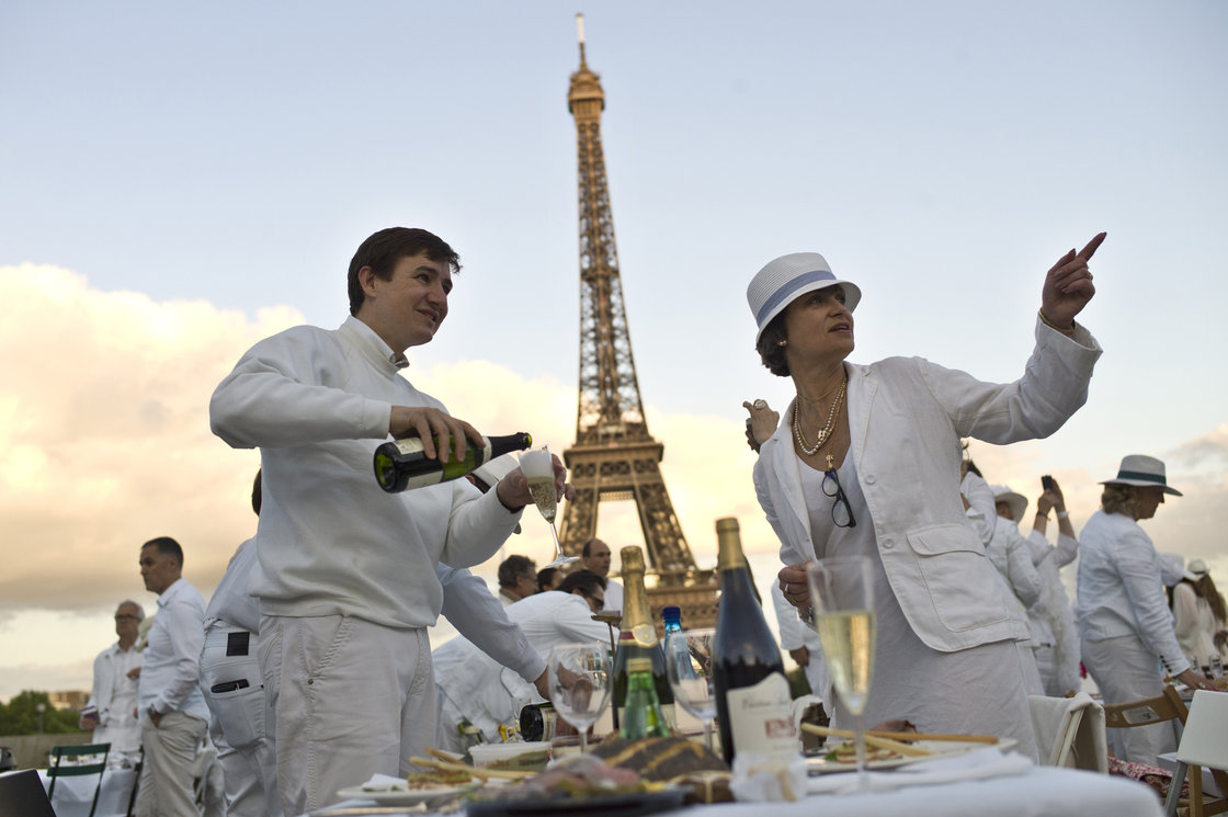 Diner en Blanc began in Paris 25 years ago. This year, Paris hosted the event in the Trocadero gardens, in front of the Eiffel Tower. Photo: Thibault Camus/AP