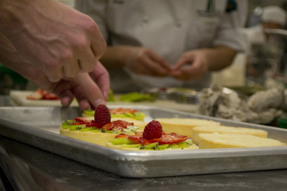 Culinary students at City College of San Francisco prepare fruit tarts at the Downtown campus. Photo: Sara Bloomberg