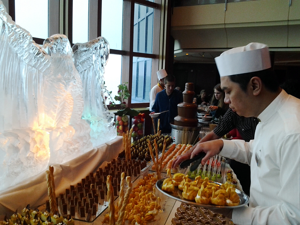 Brunch dessert buffet with ice sculpture. Photo by Mary Ladd