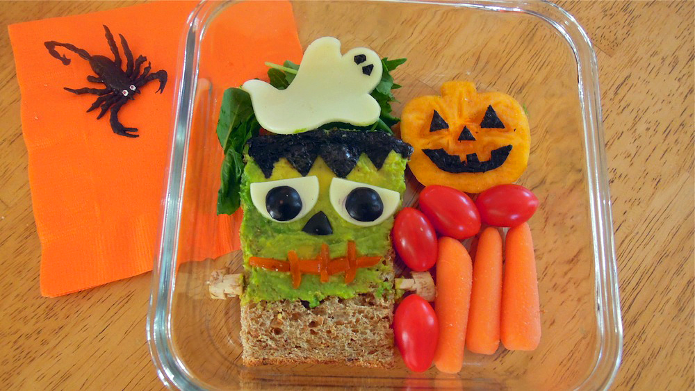 Frankenstein bento, with cheese ghost and persimmon pumpkin. Photo + Bento: Anna Mindess