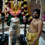Hindu priest posing with mobile statue of Ganesha. Photo: Wendy Goodfriend