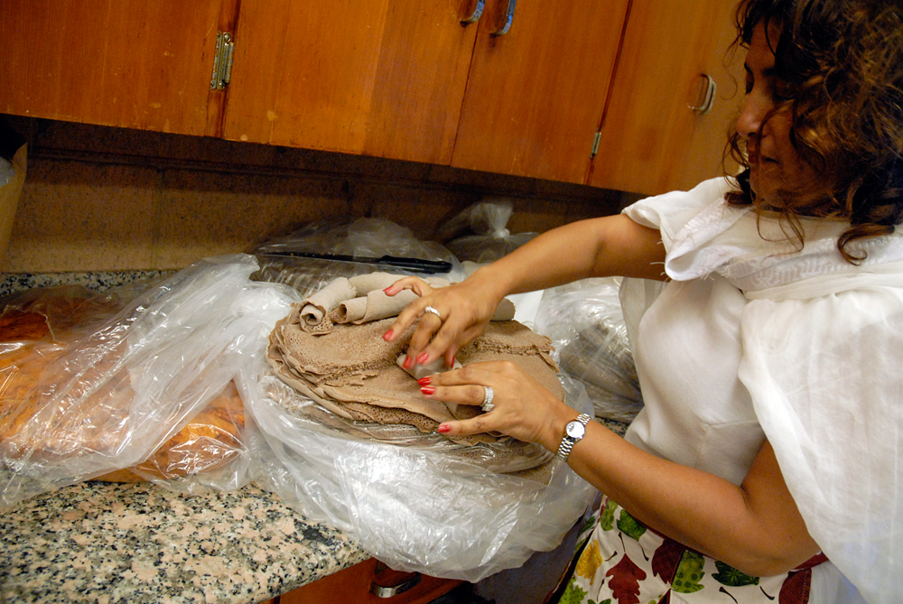 A woman rolls injera to prep for the feast. Photo: Wendy Goodfriend