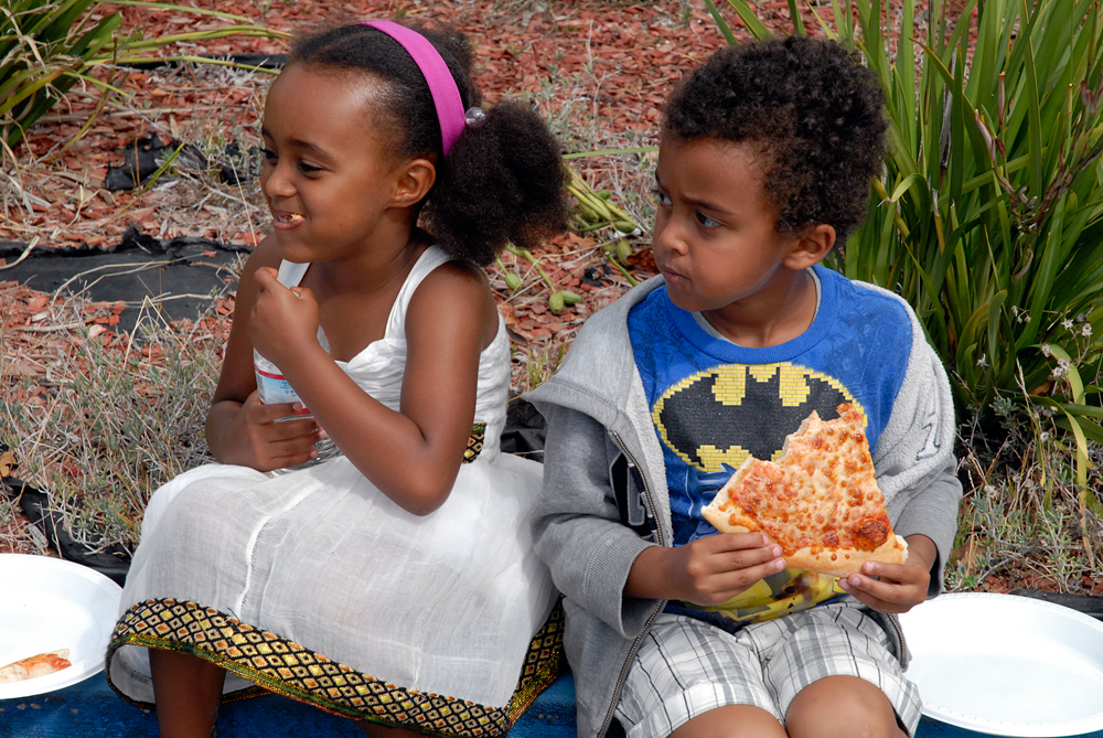 Children snacked on pizza at the Meskel celebrations