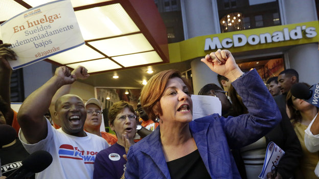 New York City Council speaker and then-mayoral candidate Christine Quinn speaks at a fast-food workers' protest outside a McDonald's in New York in August. A nationwide movement is calling for raising the minimum hourly wage for fast-food workers to $15. Photo: Richard Drew/AP