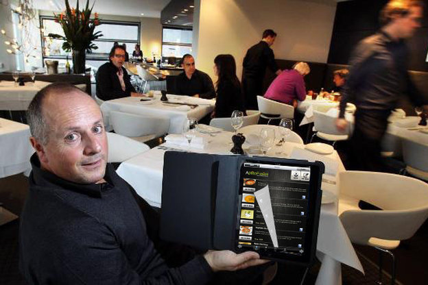 A restaurant customer tries out the Aptito app on a digital menu. Photo: Courtesy of Aptito