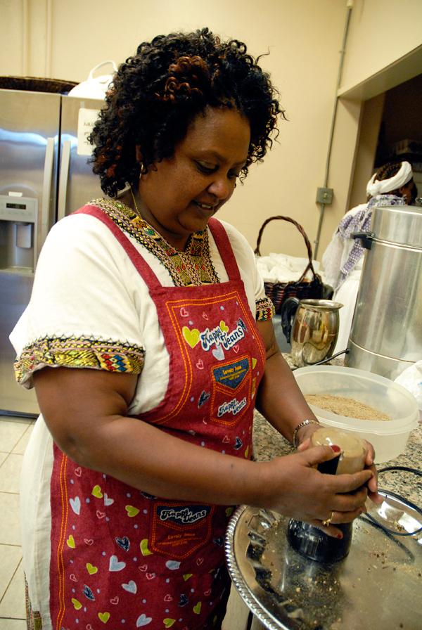 Mulu Reda grinding coriander. Photo: Wendy Goodfriend