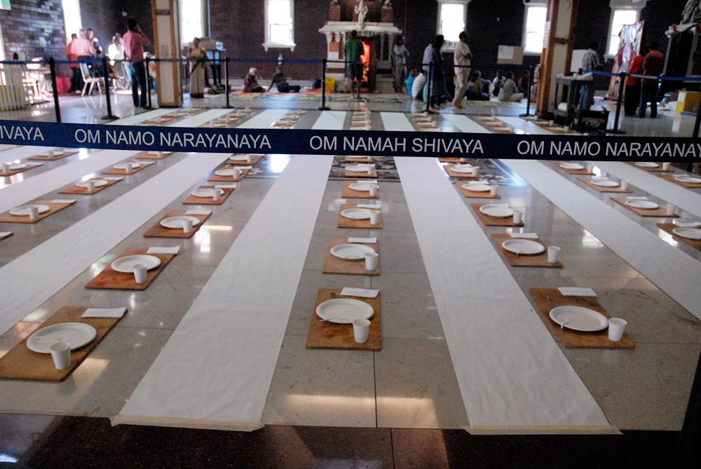 Om Namah Shivaya barricade enclosing place settings to celebrate Ganesha. Photo: Wendy Goodfriend