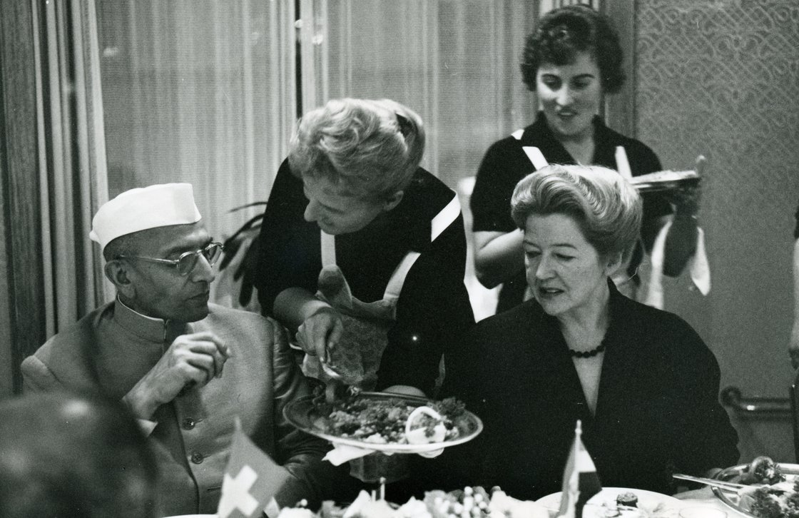 Margrith Hiltl (seat at right) brought Eastern influences to Hiltl's menu after traveling to India in the early 1950s. Here, she's seen dining with Indian Prime Minister Morarji Desai. Photo: Courtesy Hiltl