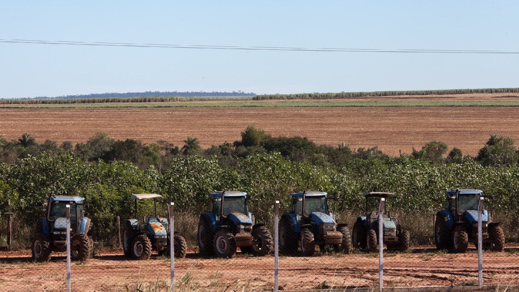 Tractors sit on a sugarcane plantation occupying the  land of a Guarani-kaiowá indigenous community in Brazil. Photo: Tatiana Cardeal/Courtesy Oxfam