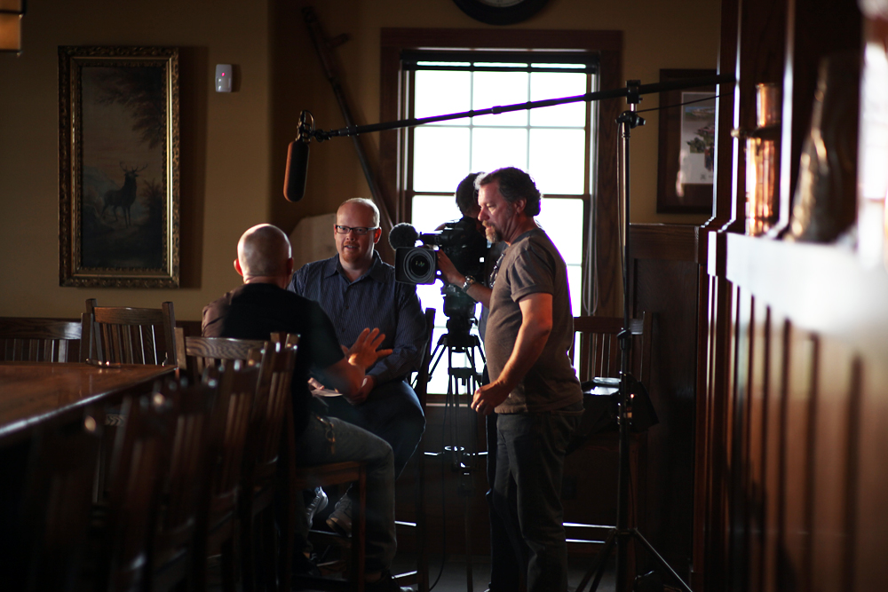 Director Joseph Levy (center) interviews Mike Breitbach. Photo courtesy of Spinning Plates